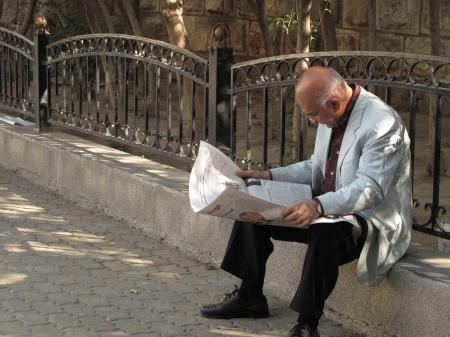 Man & newspaper, Damascus