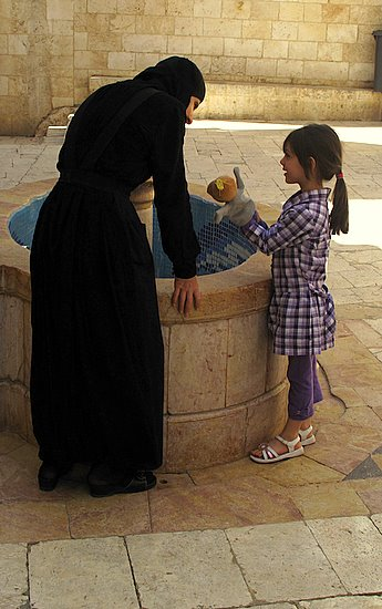 A nun and visitor in Seidnayya, Syria
